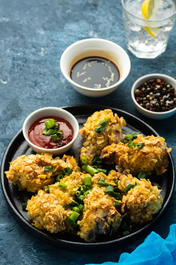 Chicken wings in breading. Deep fried chicken wing. American foo. D stock image