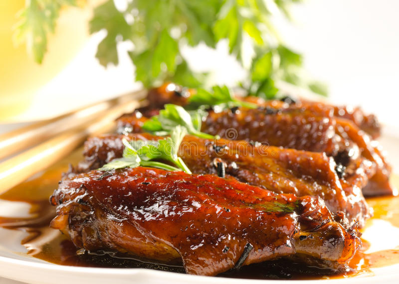 Chicken wings in chinese sauce with puer tea and h. Erbs. Selective focuse. Horisontal. vertical crop available royalty free stock images