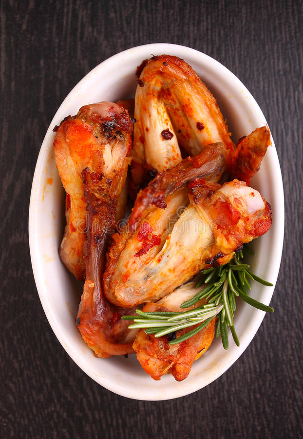 Chicken wings fried in tomato sauce royalty free stock images