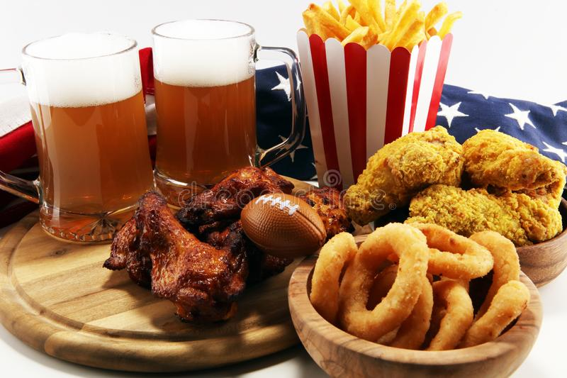 Chicken wings, fries and onion rings for football on a table. Great for Bowl Game royalty free stock photos
