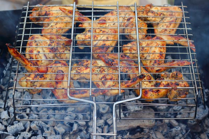 Chicken wings on grill stock photo
