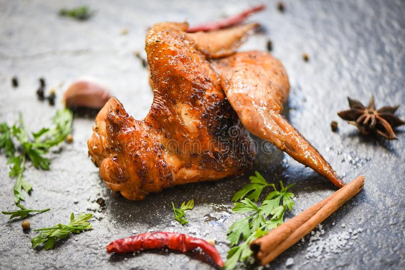 Chicken wings grill with garlic chilli herbs and spices on black plate top view - Baked chicken wings BBQ stock photo