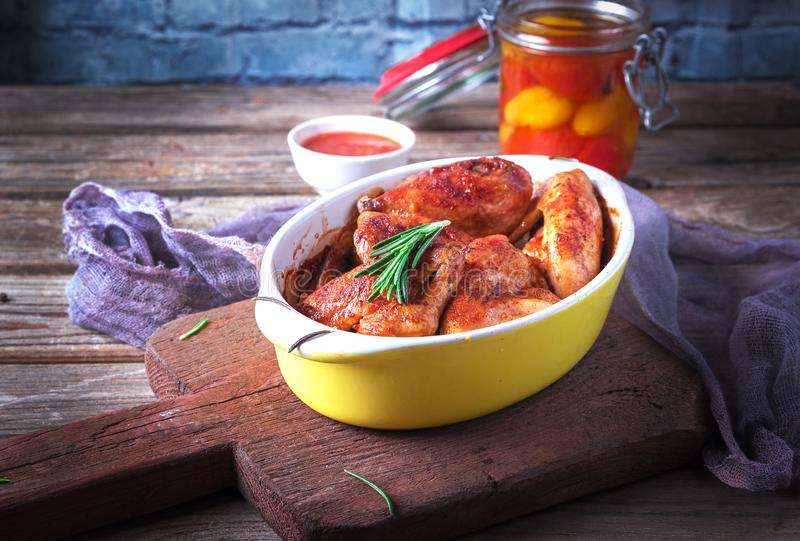 Chicken Wings, Oven Baked and Grilled. Homemade Tasty Food. Wood Table Background, Rustic Still Life Style.  royalty free stock photos