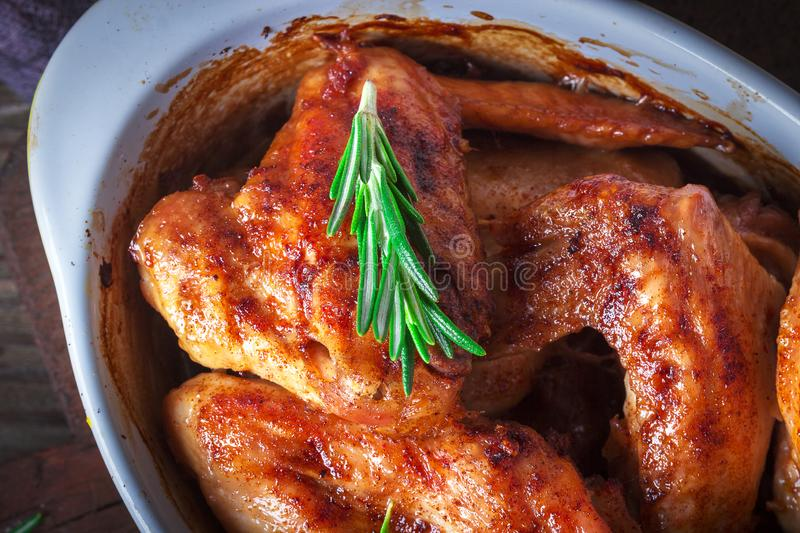 Chicken Wings, Oven Baked and Grilled. Homemade Tasty Food. Wood Table Background, Rustic Still Life Style. Close up.  stock image