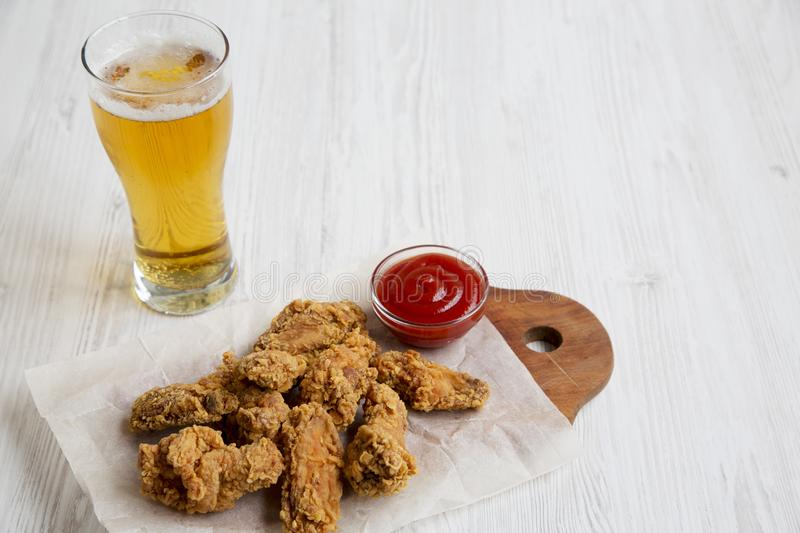 Chicken wings with red pepper sauce, cold beer. stock image