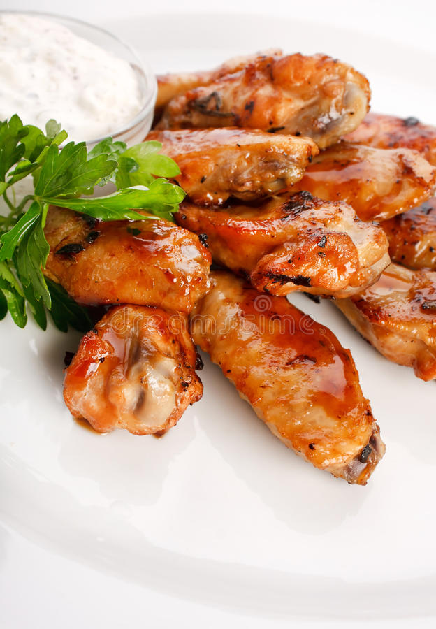 Chicken wings with sauce stock images