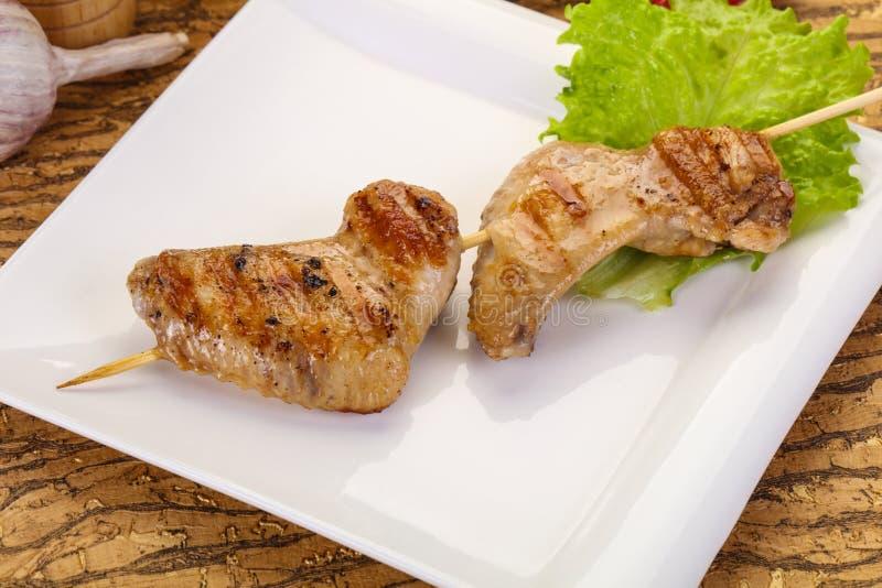 Chicken wings skewer stock images