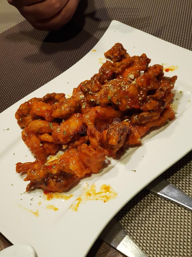 Chicken wings with white plate and red sauce. Dinner, hunger stock photography