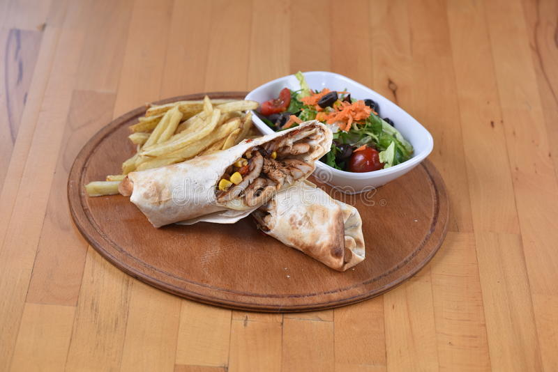 Chicken Wrap/Dürüm. Served with potato and salad stock photography