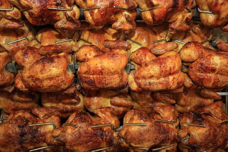 Chickens roasting in Rotisserie in Germany royalty free stock photography
