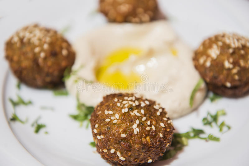 Chickpea falafel balls with hummus stock image