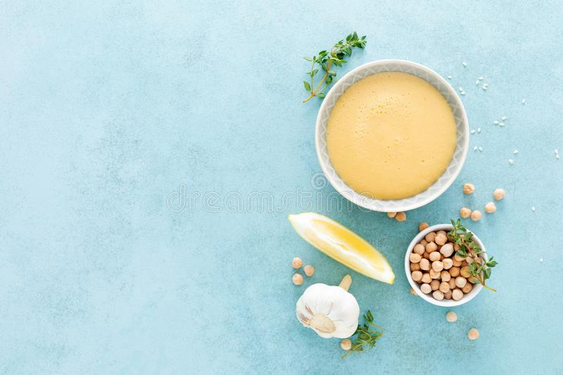 Chickpea sauce with fresh lemon juice, sesame seeds, garlic and olive oil, hummus royalty free stock photo