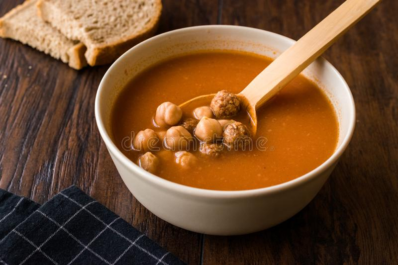 Chickpea Soup Stew with Meatballs and Wooden Spoon / Spanish Potaje de Garbanzos. Traditional Dish stock images
