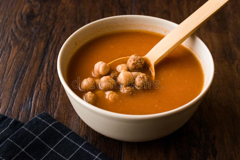 Chickpea Soup Stew with Meatballs and Wooden Spoon / Spanish Potaje de Garbanzos. Traditional Dish royalty free stock images