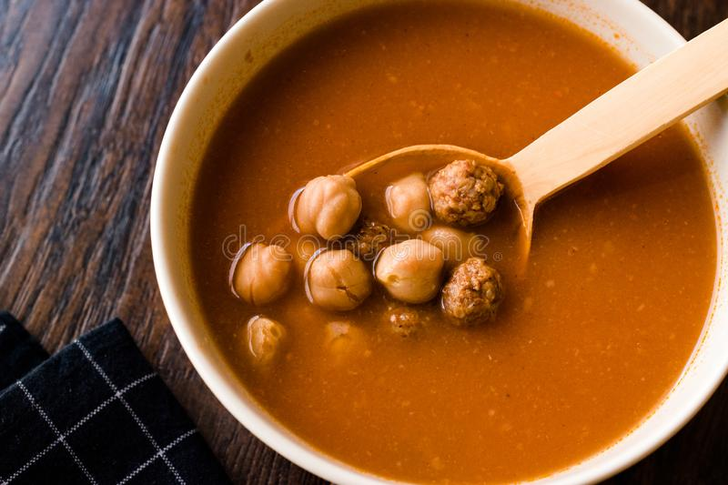 Chickpea Soup Stew with Meatballs and Wooden Spoon / Spanish Potaje de Garbanzos. Traditional Dish stock photo