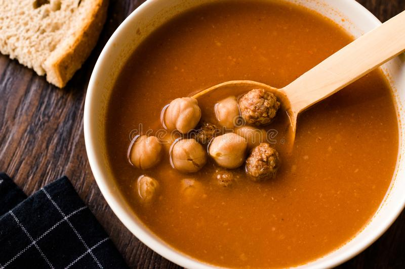 Chickpea Soup Stew with Meatballs and Wooden Spoon / Spanish Potaje de Garbanzos. Traditional Dish royalty free stock photography