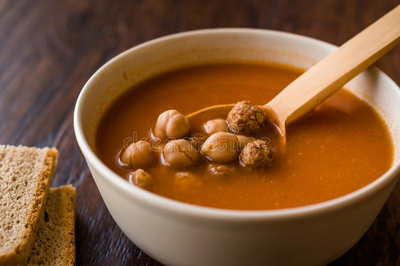Chickpea Soup Stew with Meatballs and Wooden Spoon / Spanish Potaje de Garbanzos. Traditional Dish stock image