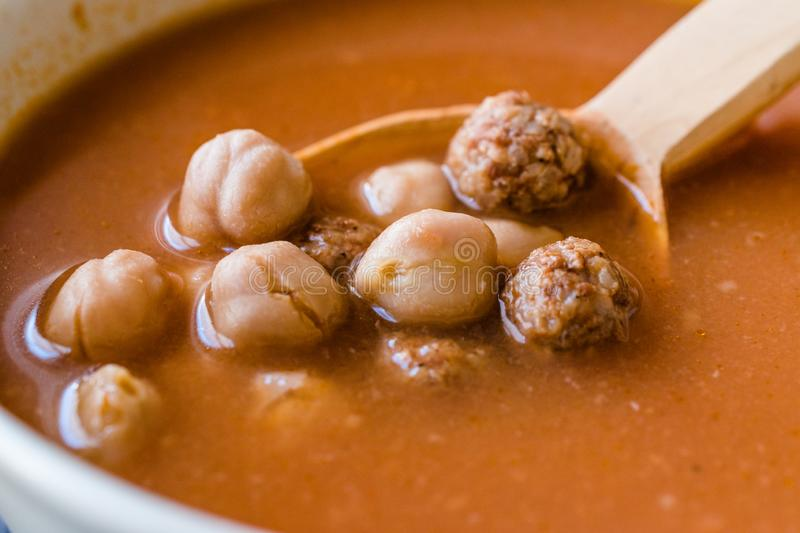 Chickpea Soup Stew with Meatballs and Wooden Spoon / Spanish Potaje de Garbanzos. Traditional Dish royalty free stock photos