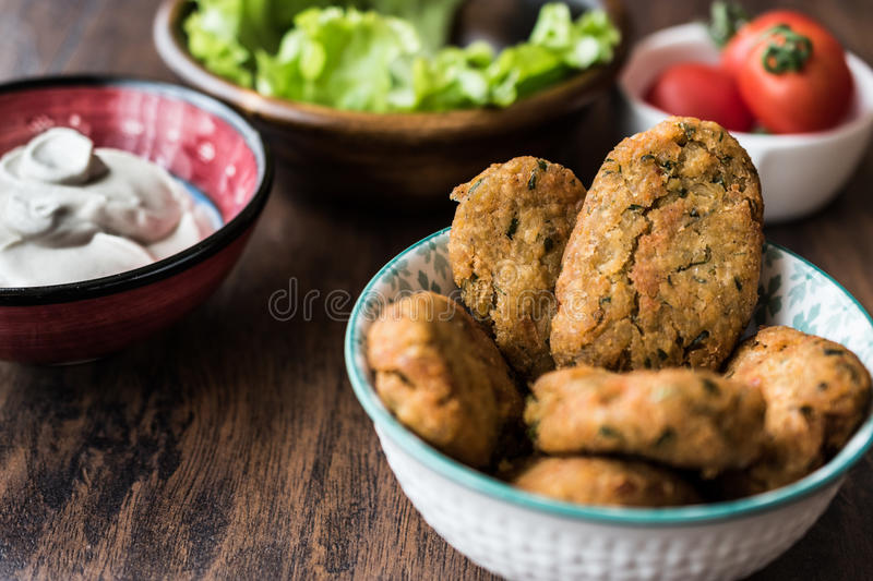 Chickpeas Falafel with sauce , cherry tomatoes and parsley. stock images