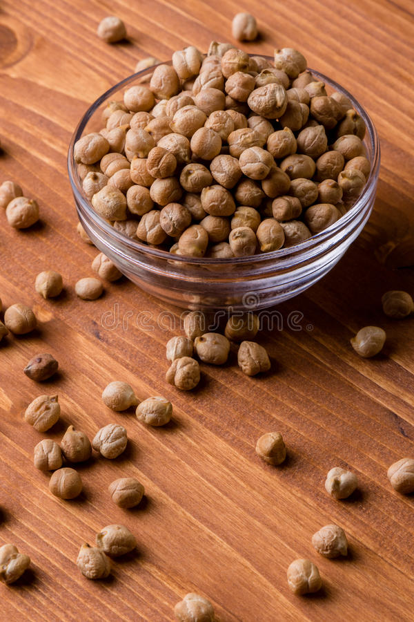 Chickpeas in a glass bowl stock images