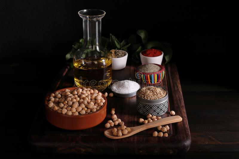 CHICKPEAS HUMMUS INGREDIENTS IN A TABLE OF WOOD stock photography