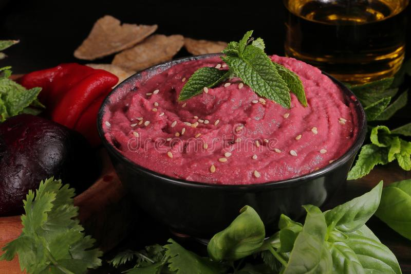 CHICKPEAS HUMMUS MADE WITH BEETTROOT royalty free stock photography