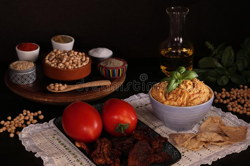 CHICKPEAS HUMMUS MADE WITH TOMATOES royalty free stock photos