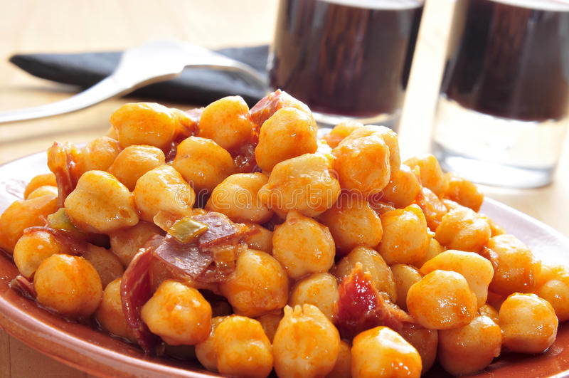 Chickpeas with serrano ham. Closeup of a plate with spanish garbanzos con jamon, chickpeas with serrano ham, served as tapas stock images