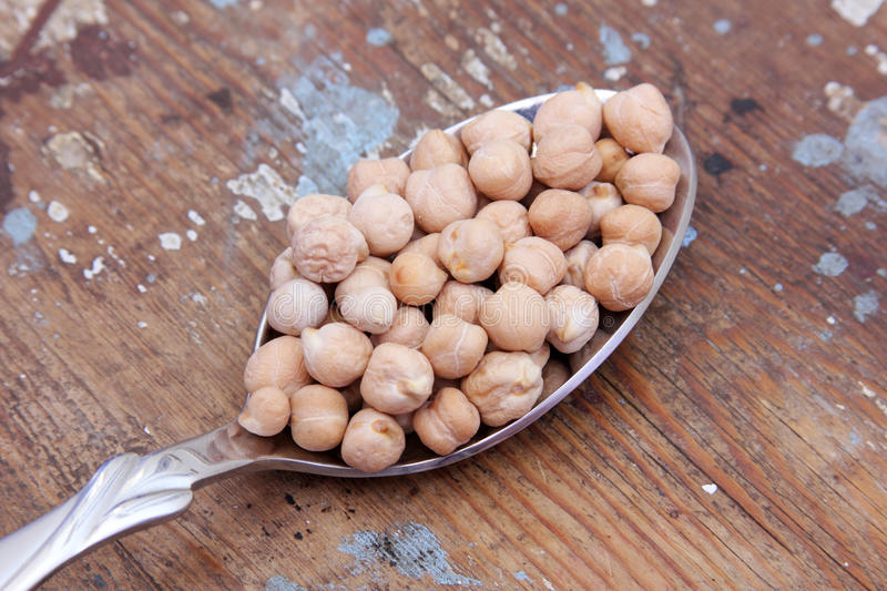 Chickpeas on spoon royalty free stock images