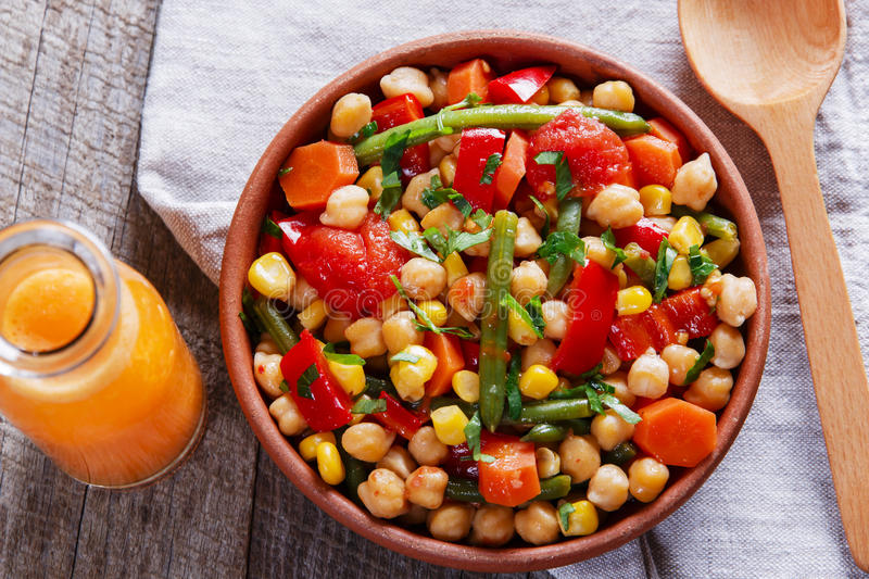 Chickpeas with tomato carrot green beans corn. Chickpeas with tomato carrot green beans royalty free stock images