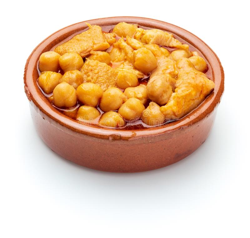 Chickpeas with tripe callos in clay pot. stock photo