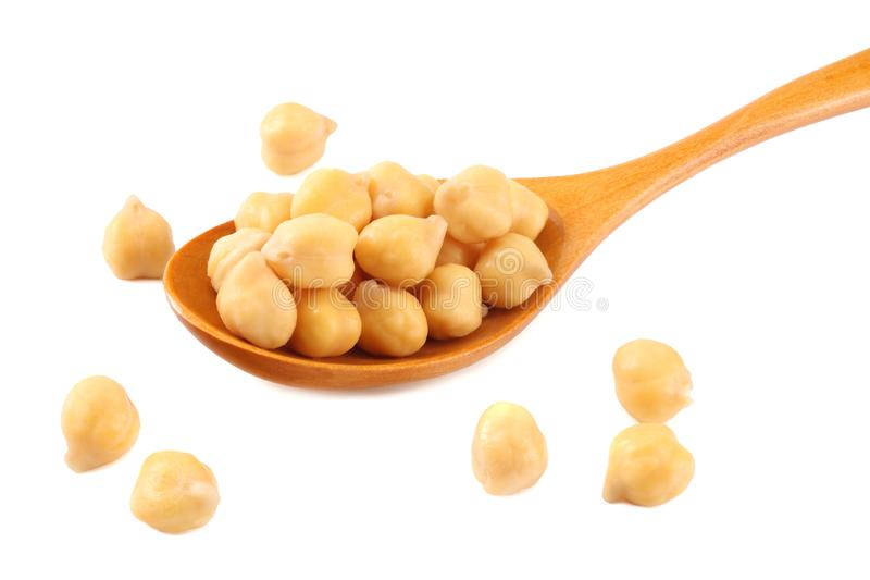 Chickpeas in wooden spoon isolated on white background stock photos