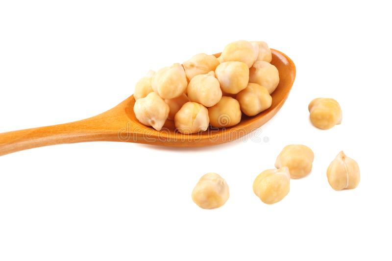 Chickpeas in wooden spoon isolated on white background royalty free stock photos