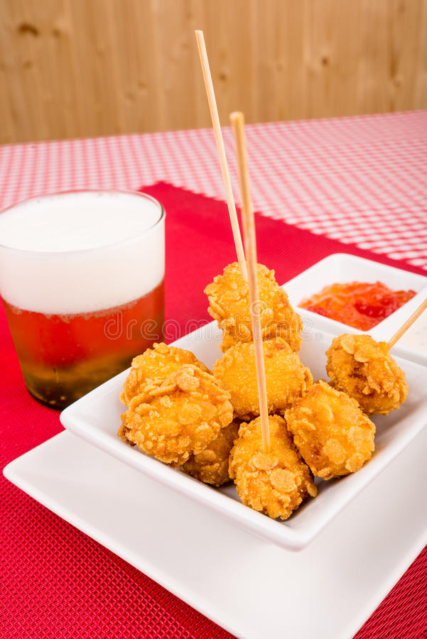 Chickuen croquette tapa. Chicken croquette tapa served with a choice of dips stock images
