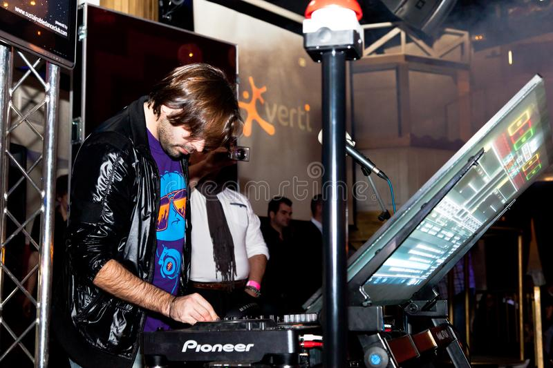 Disco Party on Chiclana de la Frontera, Spain. CHICLANA, SPAIN - JAN 27: DJ Alvaro Reina next to the mixer to begin the party of the hot mix energy danceflor of stock images