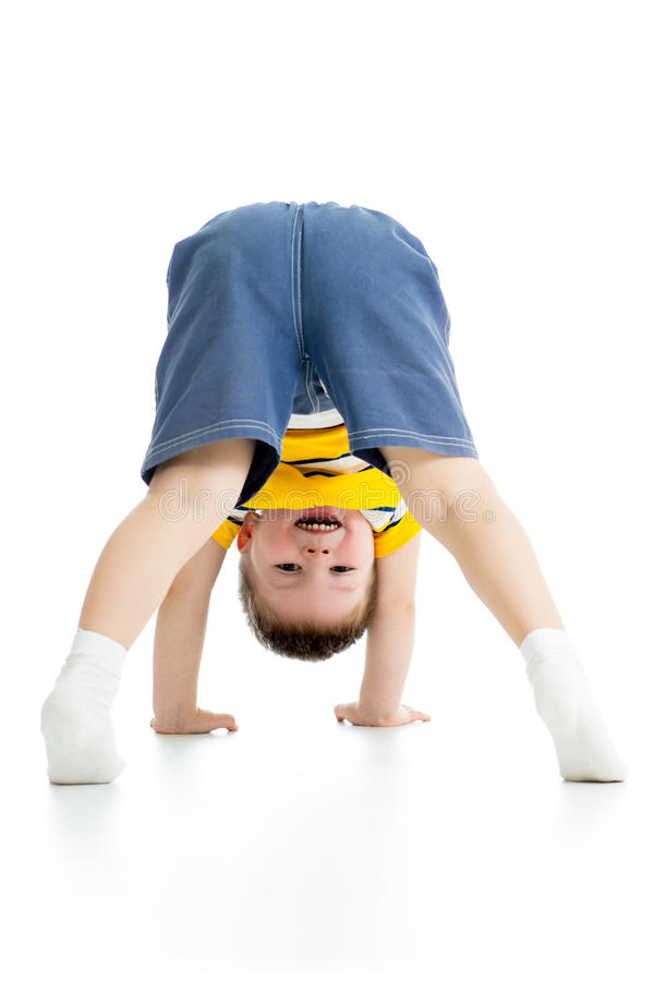 Chid boy upside down. Over white background royalty free stock photography