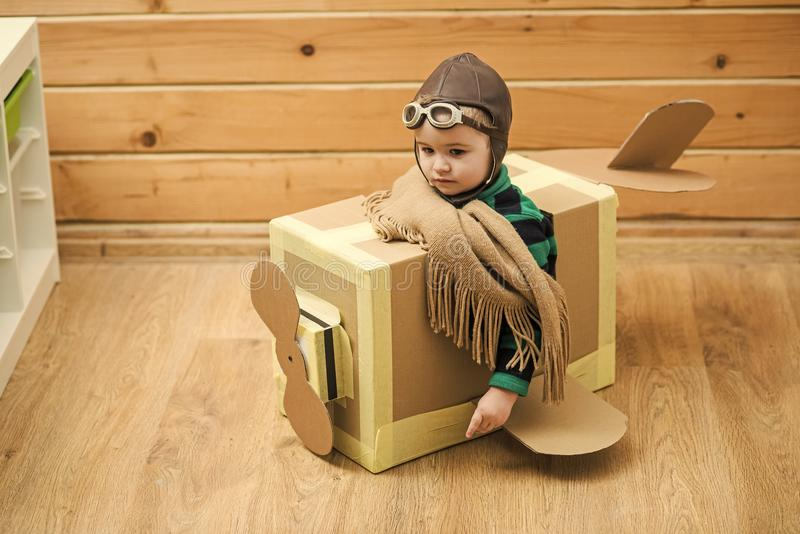 Chidhood dream. Little Child Playing Airplane Pilot. Kid Traveler Flying in Aviator Helmet, Travel, Vacation Trip Concept royalty free stock image