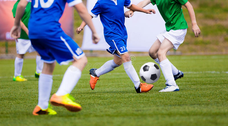 Chidren Playing Football Soccer Game on Sports Field. Boys Play Soccer Match. On Green Grass. Youth Soccer Tournament Teams Competition stock images