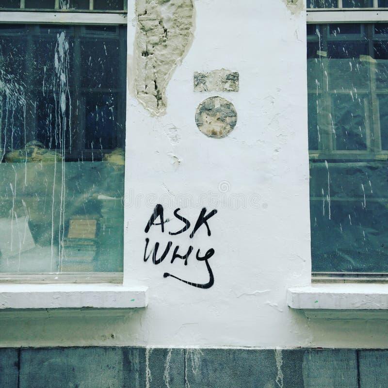 Chieda perché arte della via fotografie stock