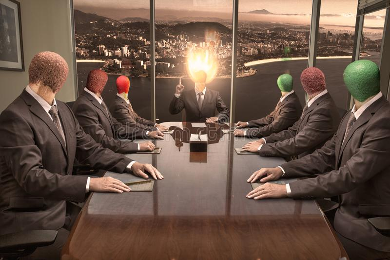 Men with match heads on shoulders hold a production meeting. The chief with a burning match instead of the head holds a production meeting with his subordinates royalty free stock photography