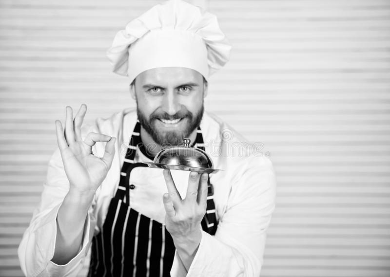Chief cook gesturing ok sign. Master chef serving meal in restaurant. Handsome man in apron and cook hat. Chef cook in royalty free stock images