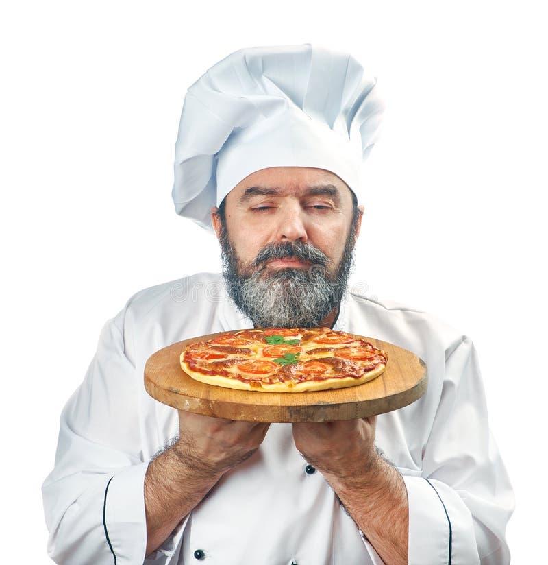 Chief cook holding pizza napoletana. Isolated on white stock photos