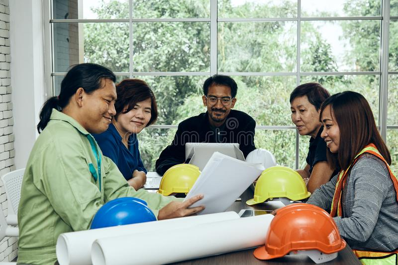 Chief Engineer meeting together with secretary and site workers royalty free stock image