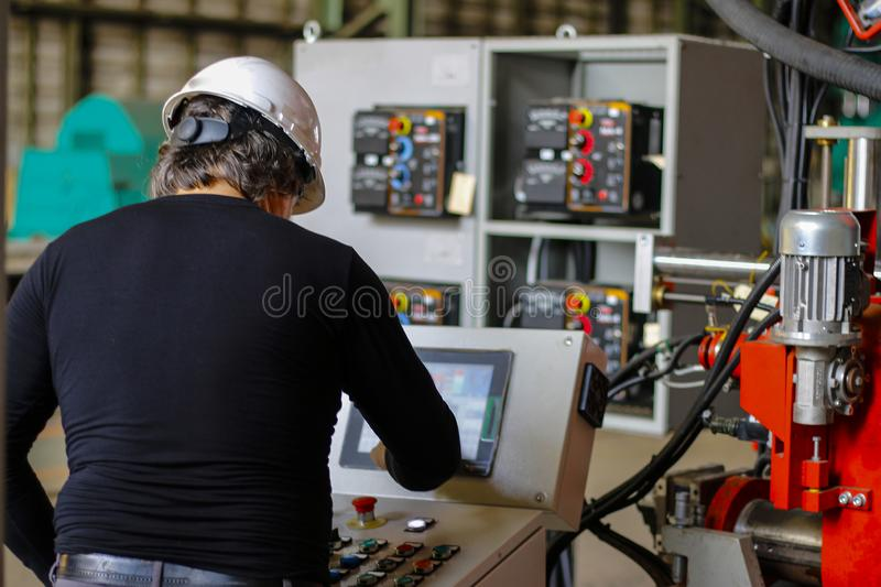 chief engineer setting up the machine steel cutting royalty free stock photography