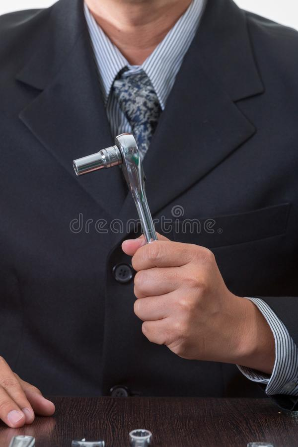Chief mechanical engineer holding many tools royalty free stock images