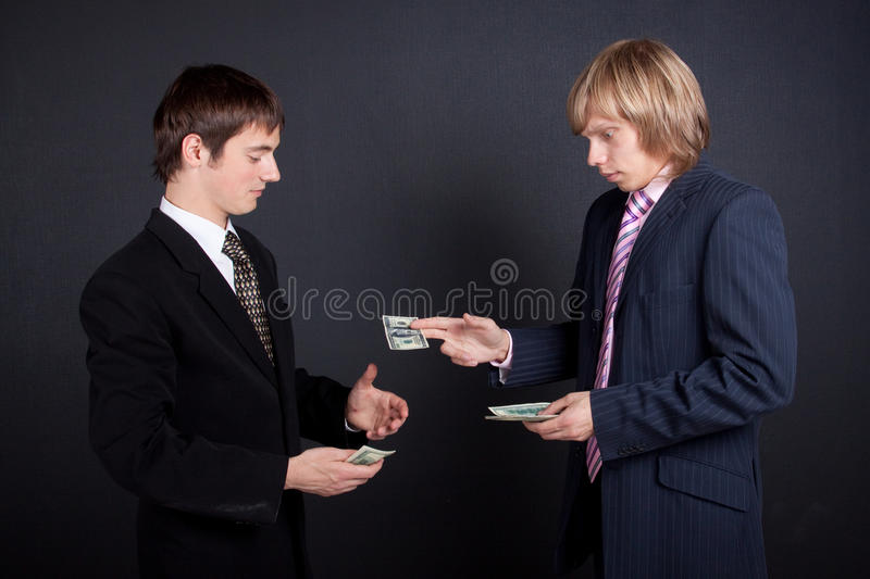 Chief pay out a salary. stock photography