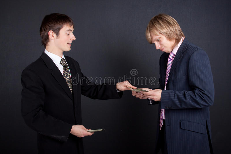 Chief pay out a salary. stock images