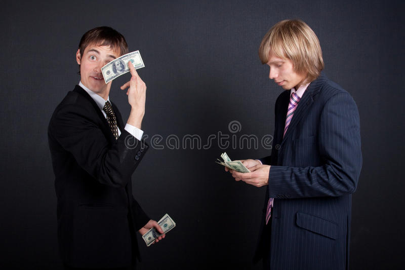 Chief pay out a salary. royalty free stock photo