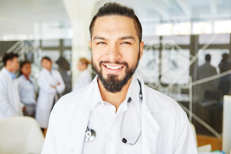 Chief physician with team in hospital royalty free stock photography