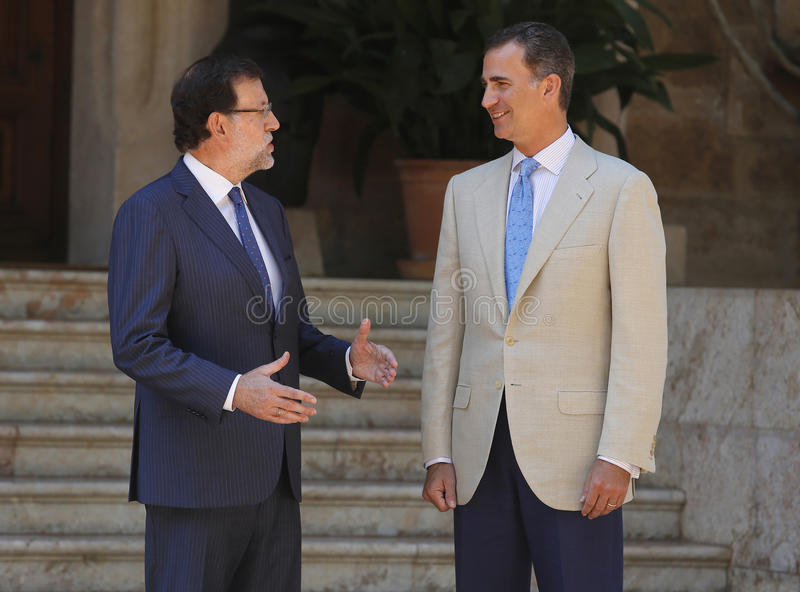 Chiefs of spain. Spains king Felipe (R) and prime minister Mariano Rajoy gesture during a meeting in the Marivent palace on the island of Majorca, Spain royalty free stock image
